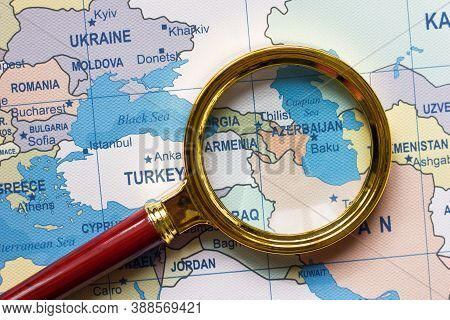Armenia, Azerbaijan, Georgia A Map Of Asia In A Defocused Magnifying Glass, The Theme Of Travel And