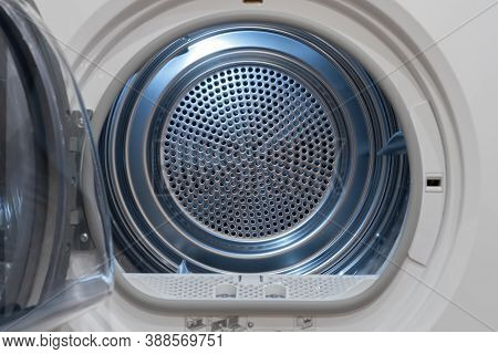 View Inside Of A Clothes Dryer, Close Up. Empty Tumble Dryer.