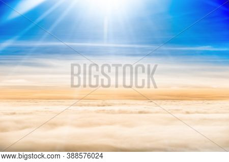 Beautiful Airview With Blue Sky, White Fluffy Clouds And Bright Sunrays Above Them. Can Be Used As N