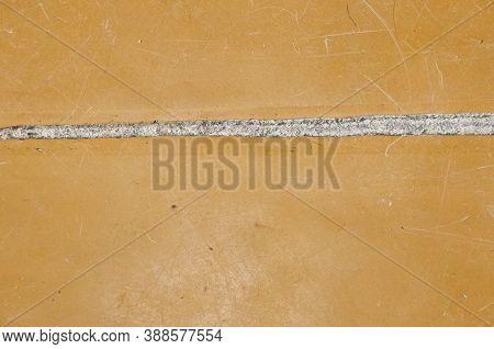 Hole In The Floor. Poor Substandard Floor Covering. Grunge Background. Flooring. Crack In Linoleum F