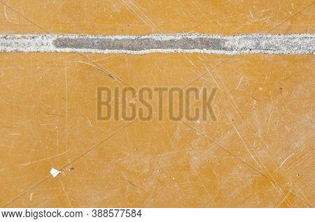 Poor Substandard Floor Covering. Grunge Background. Flooring. Copy Space. Crack In Linoleum Floor. L