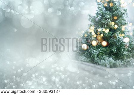 Christmas Winter Bokeh Background. Christmas Tree With Snow And Abstract Bokeh Lights. Festive Holid