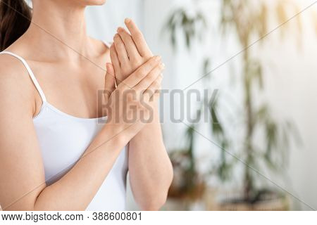 Unrecognizable Woman Rubbing Her Hands, Using Nourishing Cream At Home, Copy Space. Young Lady Using