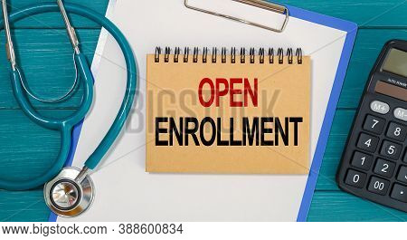 Notepad With Text Open Enrollment, Calculator And Stethoscope. Medical Concept.