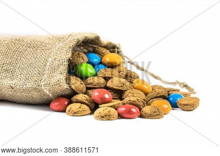Colorful Pepernoten Treats In Jute Bag On White Background For Annual Sinterklaas Holiday Event In T
