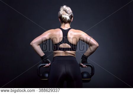 Sexy Blonde Lady Makes Workout With Weights