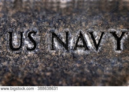 US Navy military engraved on stone symbol of naval services