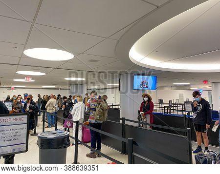 St. Louis, Mo/usa - 10/4/20:  People Walking Through The Security Line At St. Louis, Mo Lambert Inte