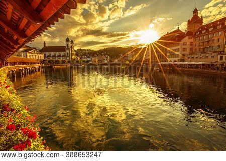 Scenic Sunset City Center Of Lucerne On Lake Lucerne, Switzerland. Jesuitenkirche Or Church Of St. F