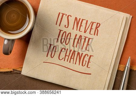 It is never too late to change - inspirational handwriting on a napkin, personal development concept