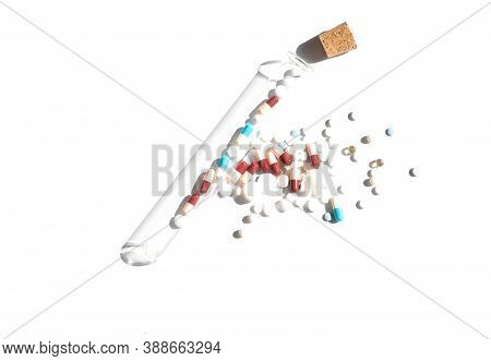 Flatlay Of Pills On White Background. Piles With Capsule And Test Tube. Pill Bottle Spilling Pills O