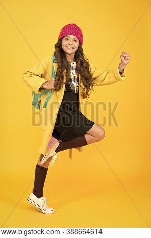 Truly Energetic. Energetic Girl Hurry To School. Active Small Child On Yellow Background. High Energ