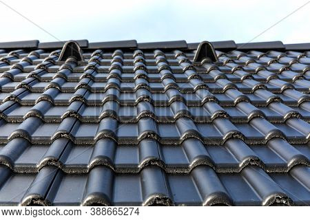 Construction Of A Family House In The Village. Construction Site Roofing Black Tiles. Black Tile Roo