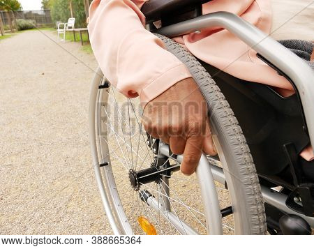 Close-up Of The Hand Of A Black Woman Pushing Her Wheelchair