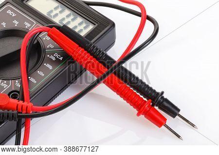 Digital Electrical Tester Multimeter In Black Case Isolated On White Background. Digital Multimeters