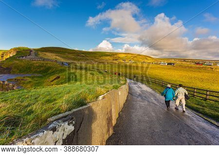 Cliffs Of Moher, Burren Way, Ireland- 07 November 2015: People Walking And Staying At The Cliffs Of