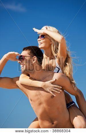 picture of happy couple in sunglasses on the beach.