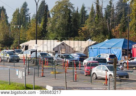 North Vancouver, Bc, Canada - Sept 4, 2020: Cars Line Up At A Drive Thru Covid 19 Testing Center In