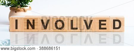 Word Involved Made With Wood Building Blocks