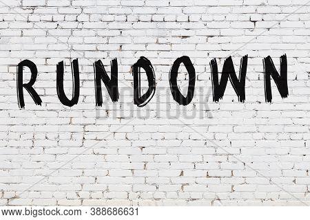 Inscription Rundown Written With Black Paint On White Brick Wall.
