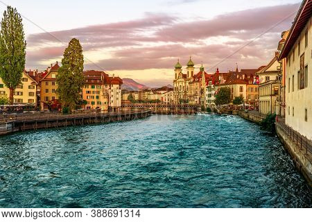 Sunset On The City Downtown Of Lucerne Of Lucerne River In Central Switzerland. Jesuitenkirche Or Je