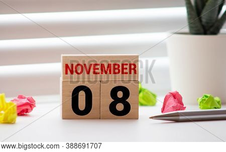 Cube Shape Calendar For November 08 On Wooden Surface With Empty Space For Text.