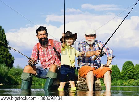 Little Boy Fly Fishing On A Lake With His Father And Grandfather. Summer Day. Happy Grandfather, Fat