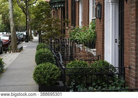 New York City, Ny / Usa - October 7 2020: Big Gray, Metal Planters With Foliage Plants In Front Of B