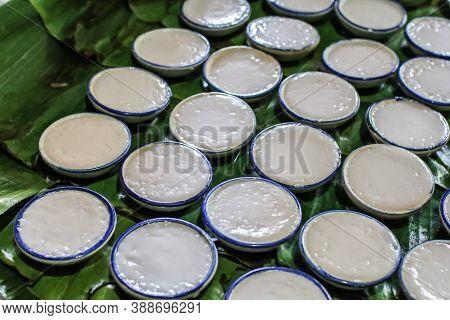 Thai Dessert-coconut Milk Custard Or Khanom Thuai In Small Porcelain Cup.steamed Pandan And Coconut