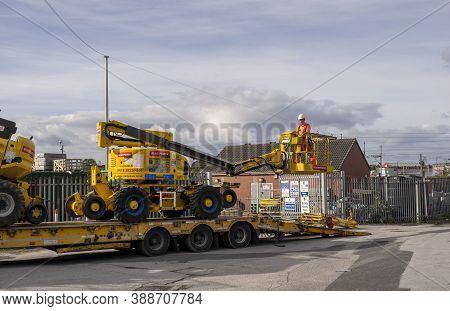 Doncaster,yorkshire, England - October 7, 2020. Worker On A High Platform From The Rail Services Bei