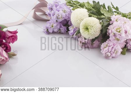 There Are Fresh Purple Pink Lisianthus Flowers Background.