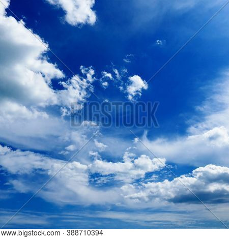 Beautiful white clouds on dark blue sky.