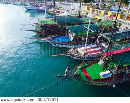 Pleasure Yachts Moored At Marina. Aerial View Of Seaside Town