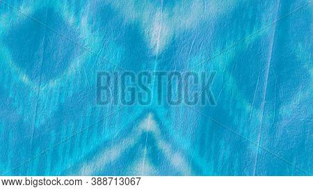 Blue Teal Ikat Design. Tie Dye Shibori. Abstract Paint Aquarel Spots. Crumpled Texture. Ogee Ikat. T