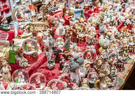 Traditional Souvenirs Snow Globes And Toys Santa Claus Dolls At European Winter Christmas Market Sou