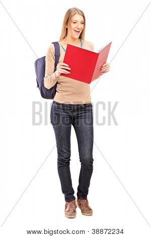 Full length portrait of a female student reading a book isolated against white background