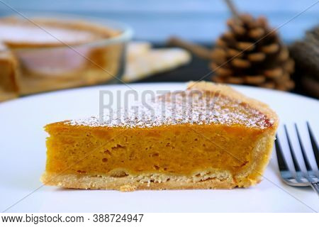 Closeup A Slice Of Delectable Homemade Pumpkin Pie For The Concept Of Autumn And Thanksgiving