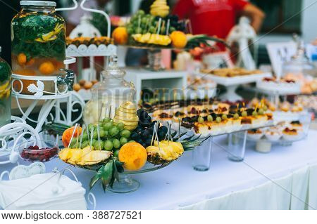 Different Fresh Fruits On Wedding Buffet Table. Wedding Table Decoration. Buffet Reception Fruits.