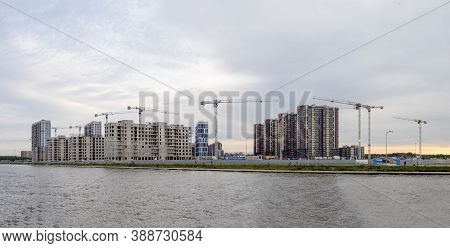 Panoramic View Of Construction Work Site And High Rise Building. High-rise Building Under Constructi