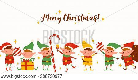 Group Of Cute Elves On Merry Christmas Horizontal Background. Funny Santa Helpers In Costumes Isolat