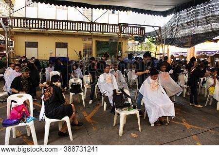 Thai People Hairdresser Or Barber Cutting Hair Charity For Local People In Market At Wat Bang Phli Y