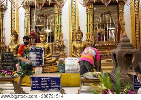 Thai People And Foreign Traveler Respect Praying And Rite Ritual God Angel Buddha Statue At Wat Bang
