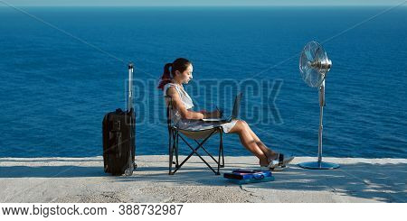Woman Working With Laptop On Beach. Business Travelling And Remote Work Concept. Life Work Balance,