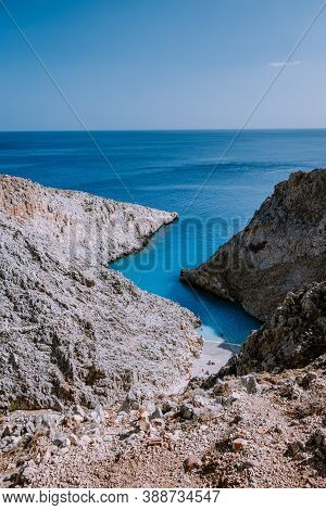 Crete Greece Seitan Limania Beach With Huge Cliff By The Blue Ocean Of The Island Of Crete In Greece