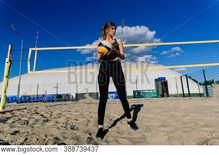 A Female Beach Volleyball Athlete With Ball On The Volleyball Court