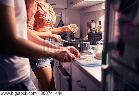 Couple Cooking In Home Kitchen. Two People Preparing A Meal And Dinner Together. Husband And Wife Ro