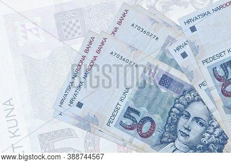 50 Croatian Kuna Bills Lies In Stack On Background Of Big Semi-transparent Banknote. Abstract Presen