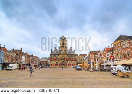 Delft, Netherlands - April 6, 2016: Stadhuis Or City Hall, Markt Square Panorama With Houses, People