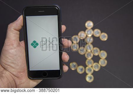 Florianopolis, Brazil. 10/07/2020: Pix Logo On The Smartphone Screen Next To Dollar Sign Made By 1 R