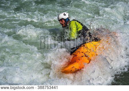 Augsburg, Germany - June 16, 2019: Whitewater Kayaking, Extreme Kayaking. A Guy In A Kayak Sails On